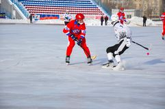 Game of bandy. Russian Premier League match ball hockey:  Lokomotiv  Orenburg  Universal  Saratov. 12.01.2013, city of Orenburg, Southern Ural, Russia Stock Photography
