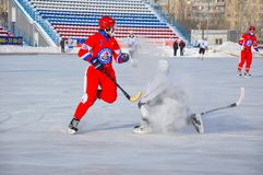 Game of bandy. Russian Premier League match ball hockey:  Lokomotiv  Orenburg  Universal  Saratov. 12.01.2013, city of Orenburg, Southern Ural, Russia Royalty Free Stock Image