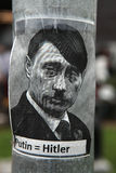 Russian president Vladimir Putin depicted as Adolf Hitler. PRAGUE, CZECH REPUBLIC - MAY 24, 2014: Sticker depicting Russian president Vladimir Putin as Adolf Royalty Free Stock Images