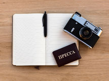 Russian Press card, open a Notepad, pen and a film camera Royalty Free Stock Photography