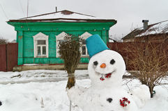 Russian province. Snowman in old town of Borovsk. Kaluga region, Russia royalty free stock photo