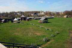 Russian provincial landscape of small provincial town - view of. Historical reconstruction of the old Fort of Torzhok with green lawn and wooden birch buildings stock photo