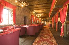 Russian pub interior. Luxurious curtains and red carpet as interior decorations at a local harbour tavern Stock Photography