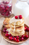 Russian quark pancakes. With condensed milk and cranberry. Selective focus Stock Photography