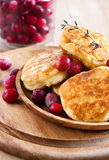 Russian quark pancakes. With cranberry. Selective focus Stock Images