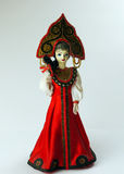 Russian queen doll. A russian doll dressed in red robe richly decorated and a diadem Royalty Free Stock Image