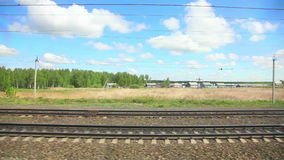 Russian railway. View to pastoral landscape in Russia out of the window of moving train stock video