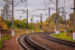 Russian railway. Rails sleepers contact network. Journey. Railway in the fall royalty free stock photo