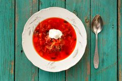 Russian red beet soup borscht with sour cream in white plate on Stock Photo