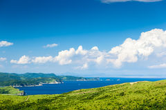 Russian resort area of the Sea of Japan. With hills, clouds, rocks and greenery in sunny day stock photos