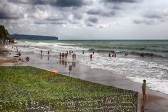 Russian resort. Golden Sands beach. 16.09.2018 21.32 pm Easy the storm allows vacationers to swim. Prohibiting swimming sign in stock image