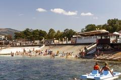 Russian resort. Russia Krasnodar region, beach village Kabardinka 26.08.2017 12: 30 pm Vacationers on the beach. Catamaran rental stock photography