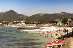 Russian resort. Russia Krasnodar region, beach village Kabardinka 26.08.2017 12: 50 pm Vacationers on the beach dive from the pier royalty free stock image