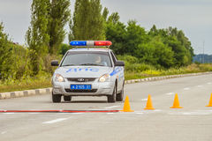 Russian road police car. Lada Priora with a special signal and a flashing light. BELGOROD, RUSSIA - JULY 23, 2017: Russian road police car. Lada Priora with a Stock Photos