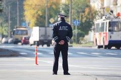 Russian road policeman patrolling the street. KEMEROVO RUSSIA SEPTEMBER 18 2016. Russian road policeman patrolling the street stock image