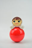 Russian roly-poly toy. Isolated red toy on white background Stock Photography