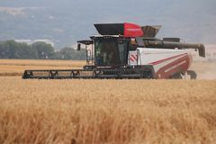 Rostselmash combine harvesting wheat in Germany royalty free stock photography