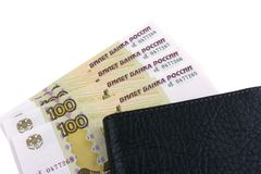 Russian rouble. Banknotes in 100 rubles with consecutive numbering. Men`s purse stock photo