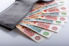 Russian rouble bills in black leather wallet Stock Image