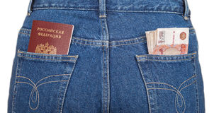 Russian rouble bills and passport in the jeans pockets Royalty Free Stock Photography