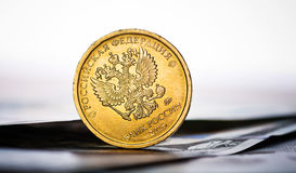 Russian rouble coin on banknotes Royalty Free Stock Image