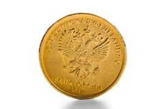 The Russian rouble coin. And gold coins Stock Images