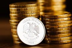 The Russian rouble coin and gold money Royalty Free Stock Photo