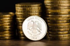 The Russian rouble coin and gold money Stock Image