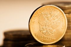 The Russian rouble coin. And gold coins Stock Photography