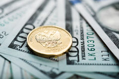 Russian rouble coin on us dollars Stock Images