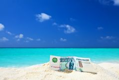Russian  roubles is on a beach Royalty Free Stock Images