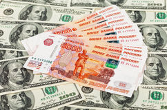 Russian roubles bills laying over U.S. dollars Stock Photo