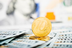 Russian roubles coins on  dollars Stock Photography