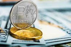 Russian roubles coins on us dollars Royalty Free Stock Photography