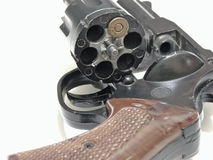 Russian roulette. Open cylinder of revolver with one bullet inside Stock Images