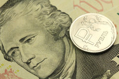 Russian ruble against the backdrop of ten US dollars Stock Photography