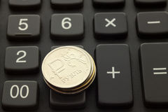Russian ruble on the calculator. Piles of Russian rubles are on the calculator Royalty Free Stock Image