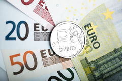 Russian ruble coin on the European banknotes Royalty Free Stock Photo