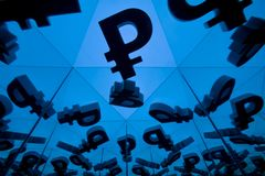 Russian Ruble Currency Symbol With Many Mirroring Images of Itself. On Blue Background stock photo