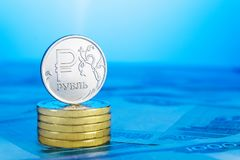 Russian ruble on a pile of coins. Royalty Free Stock Image
