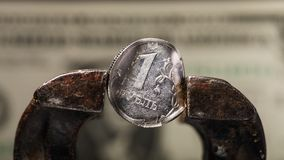 Russian ruble is in a vice. Economy of Russia is falling. And the currency of the country is depreciating Stock Photo