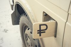 Russian ruble on the vintage car Stock Images