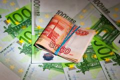 Russian rubles on the background of euro bills Stock Photos
