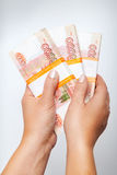Russian rubles banknotes in female hands Royalty Free Stock Images