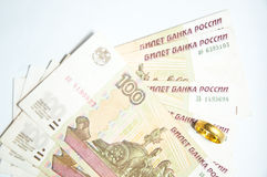 Russian rubles banknotes and gold ring Stock Photography