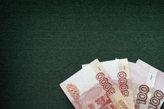 Russian rubles banknotes heap on a green background Royalty Free Stock Images
