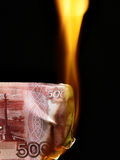 Russian rubles bills on fire Stock Photo