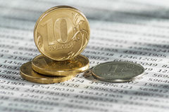 10 Russian rubles, coins lie on documents accounting. Royalty Free Stock Photography