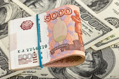 Russian rubles on dollars background Stock Photography