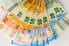 Russian rubles and euro banknotes stock images